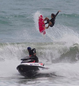 Mauro Diaz from San Juan Puerto Rico pulled into the Cocoa Beach, Florida surf by Shea Lopez aboard a Sea-Doo WAKE PRO