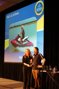 BRP Director of Advanced Concepts, Andre Cote, accepts the 2014 NMMA Innovation award at the Miami Boat Show.
