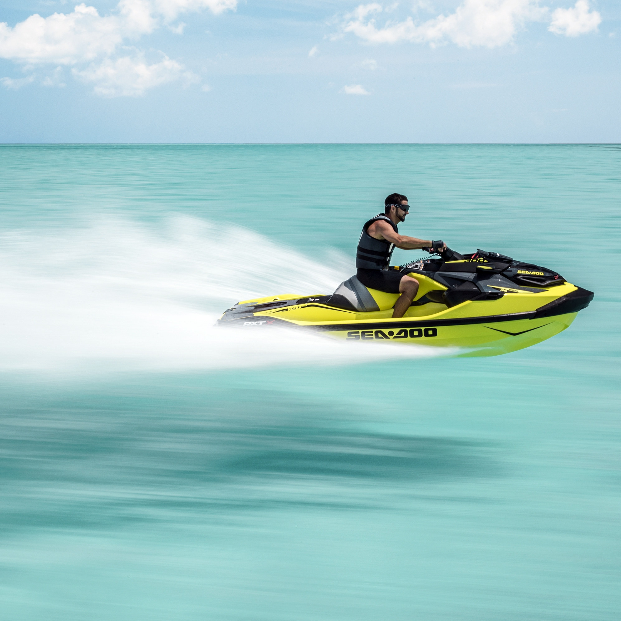 2018 Sea-Doo RXT-X in Neon Yellow and Lava Grey.
